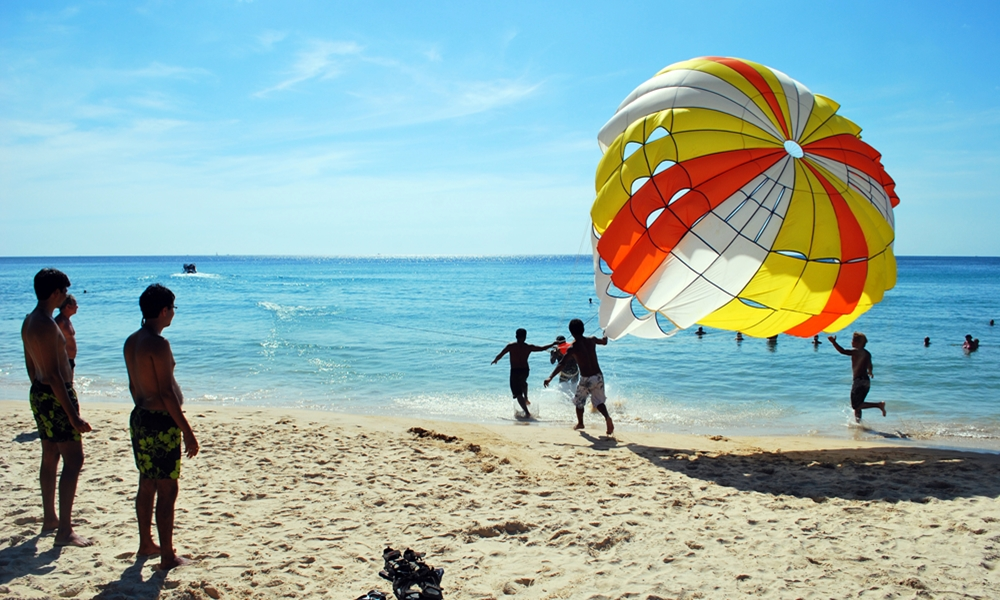 Kids parasailing at a beach in Kerala