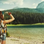A woman solo travler on her backpacking trick