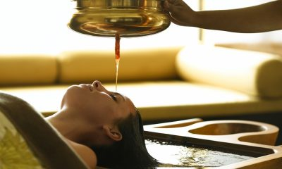 A woman experiencing authentic ayurvedic treatment