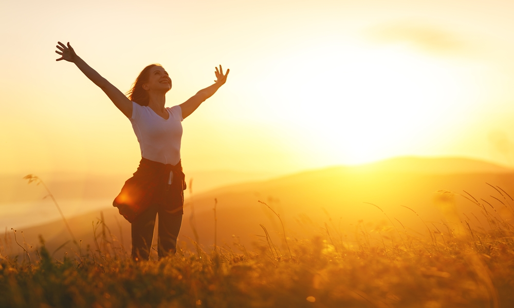 A woman enjoying fresh summer breeze during her vacation