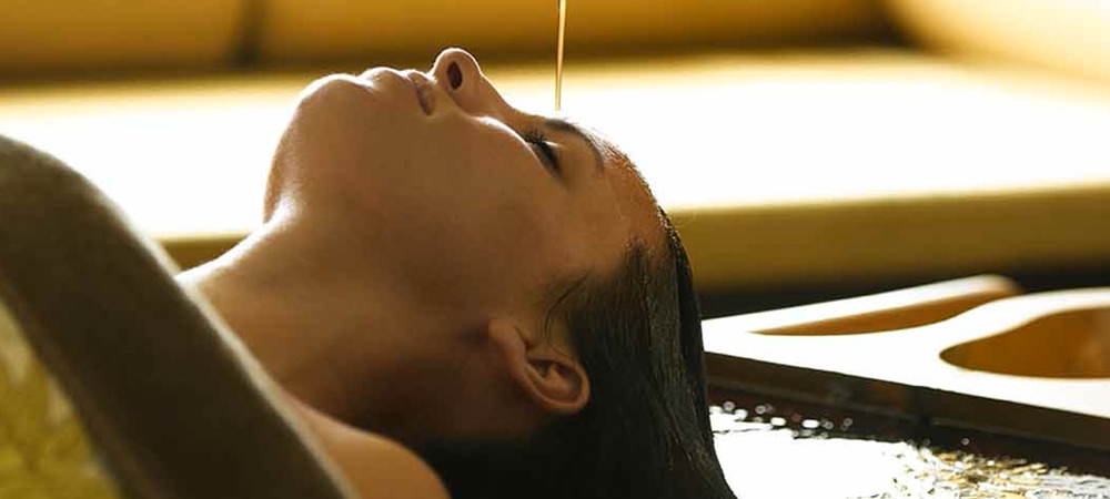 Women experiencing a soothing ayurvedic treatment