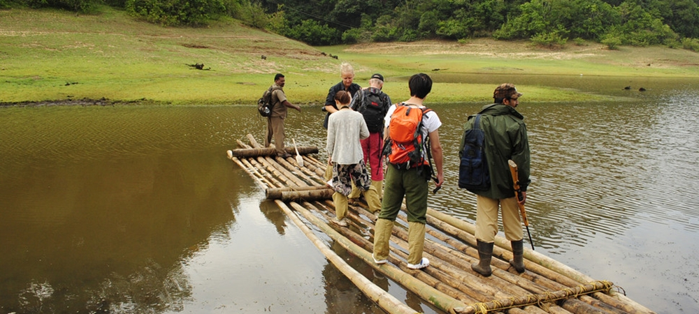 A group of travelers getting on their bamboo ride