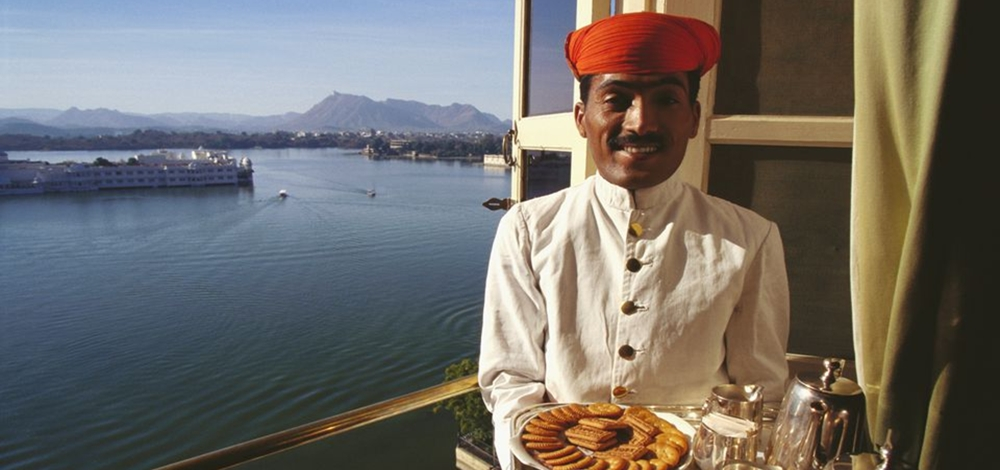 Indian waiter serving at a restaurant near the sea