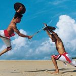 Two men practicing Kalaripayattu