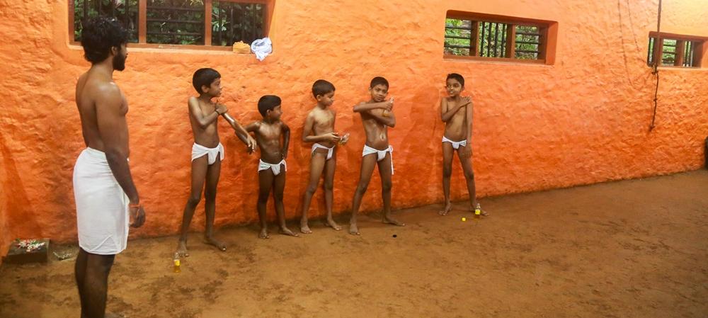 Kids applying oil before the training