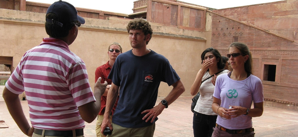 A tourist guide describing about a fort to a group of foreign tourists