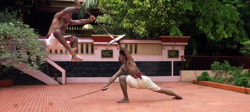 Two men using Kalaripayattu weapons