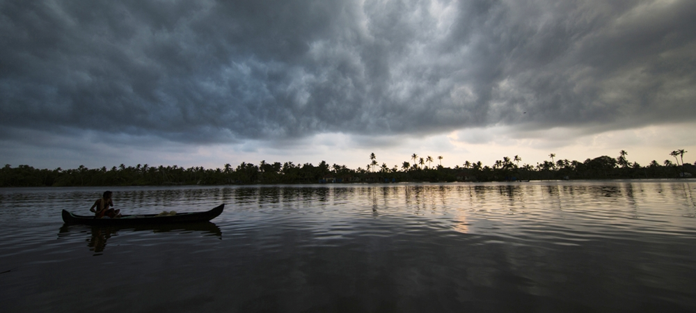 Thick dark clouds begin to cover the sky above the backwaters
