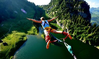 Man bungee jumping over the pond