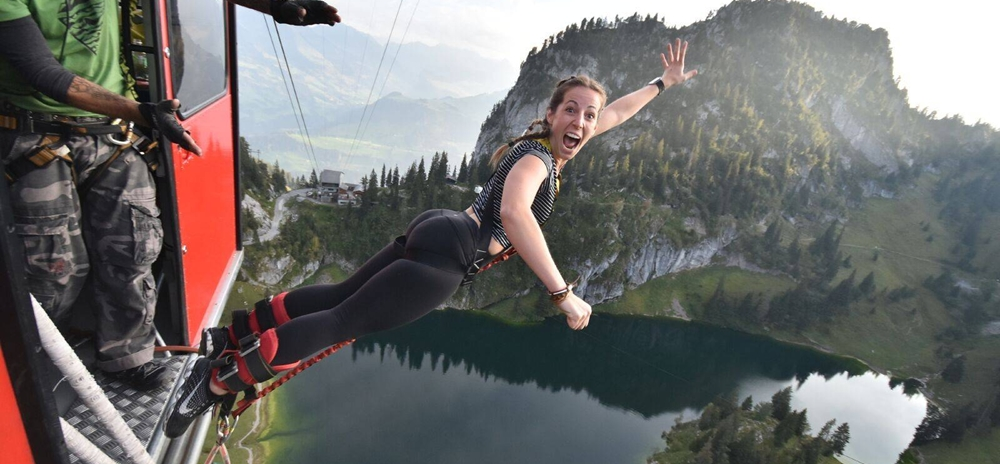 Woman screaming with joy as she jumps