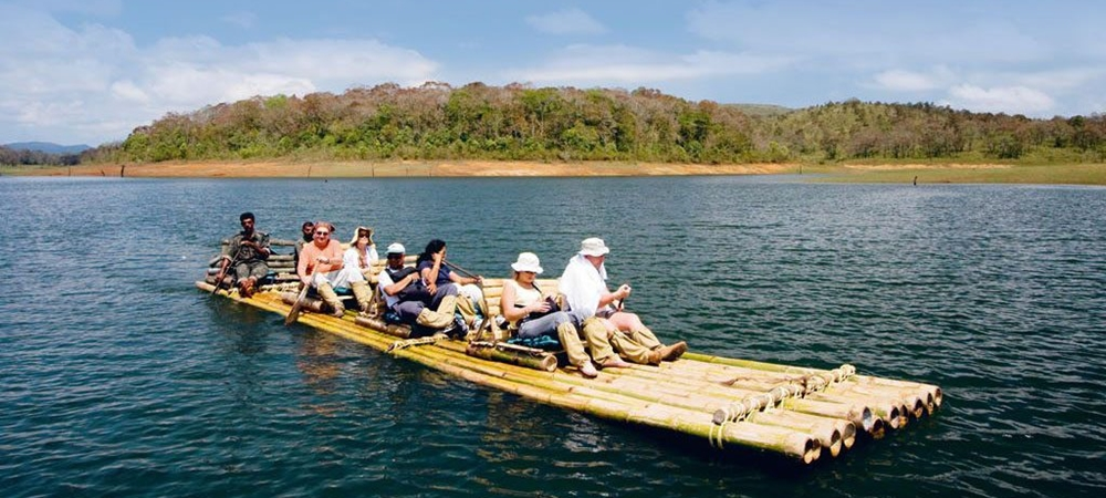 A group of travelers enjoying bamboo rafting