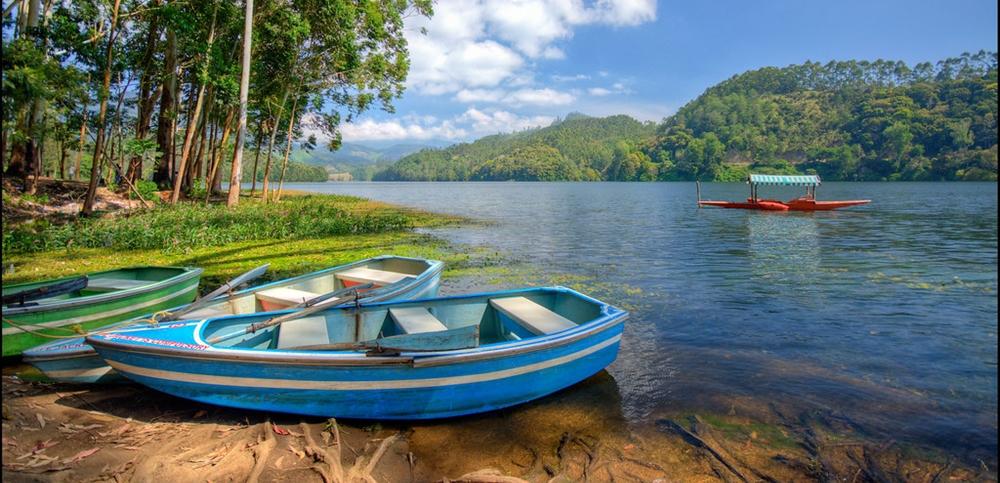 Colorful boats anchored at the shore of the Kundala Lake