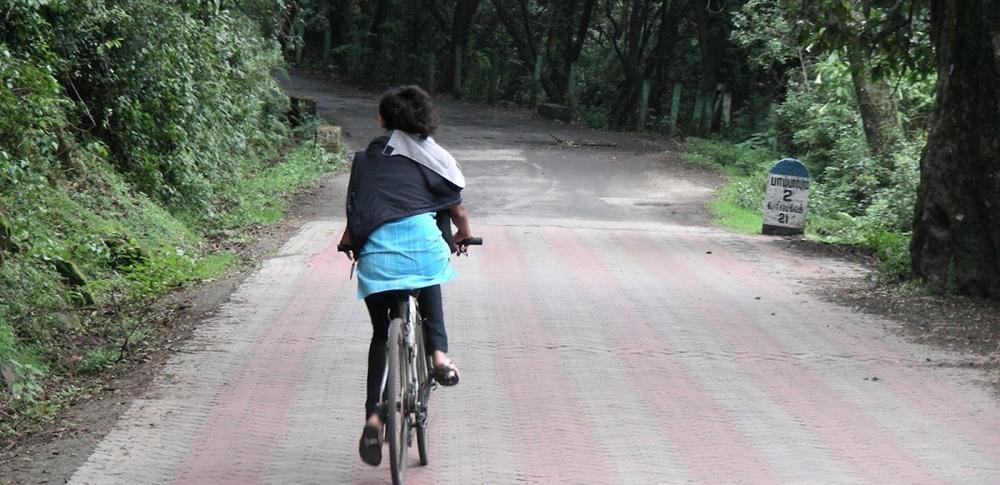 A woman enjoy a bicycle ride