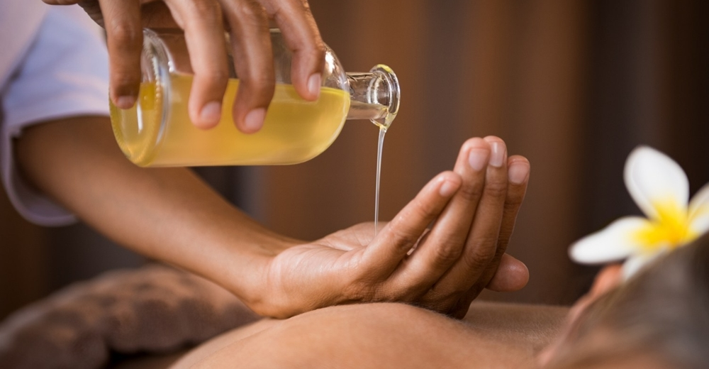 Oil being used for ayurvedic massage