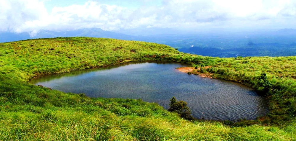 The heart-shaped lake near the pinnacle of the peak
