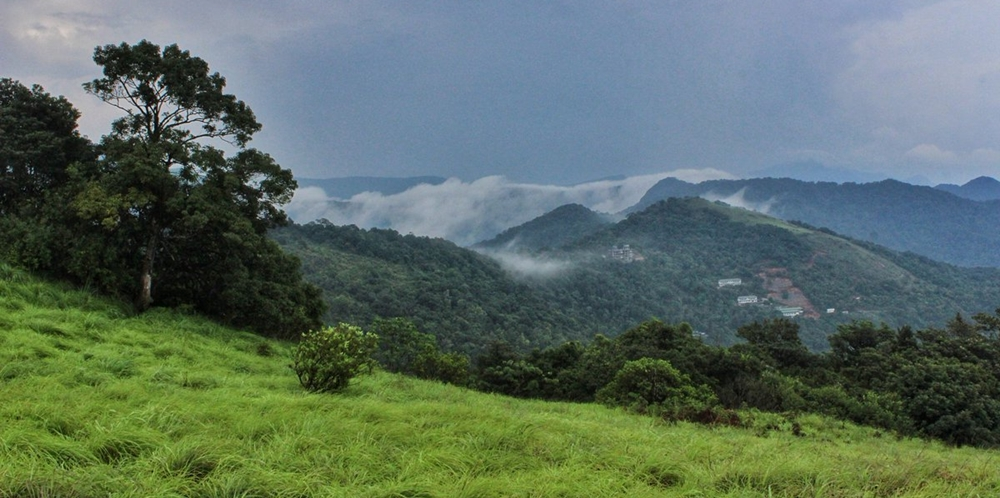 Lush greenery, clouds and hills