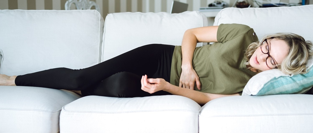 Woman feeling restless because of indigestion