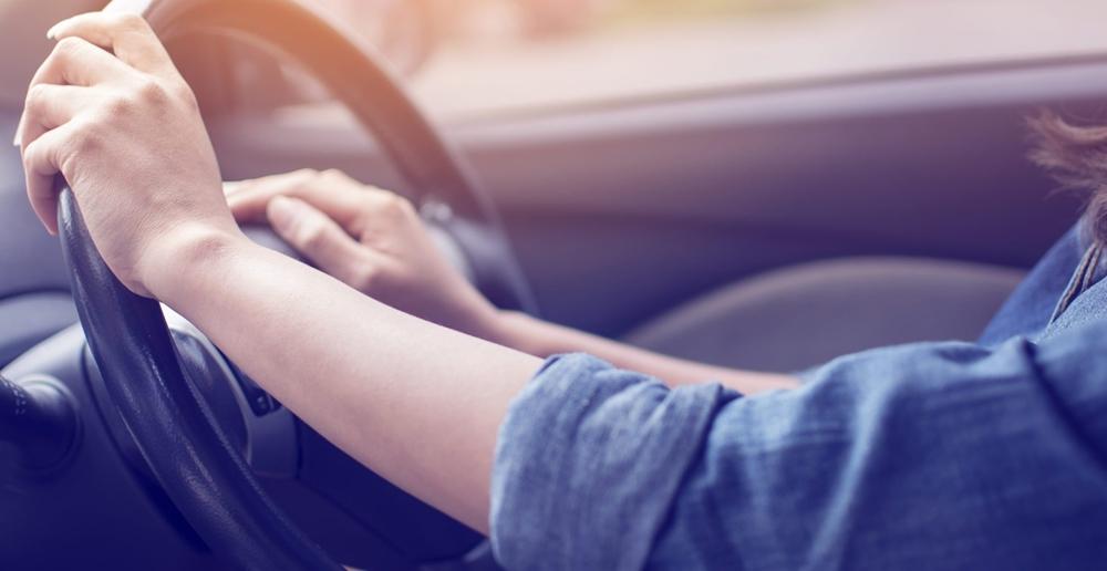 Both hands on the steering wheel
