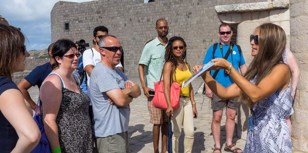 Tour guide giving information through pictures