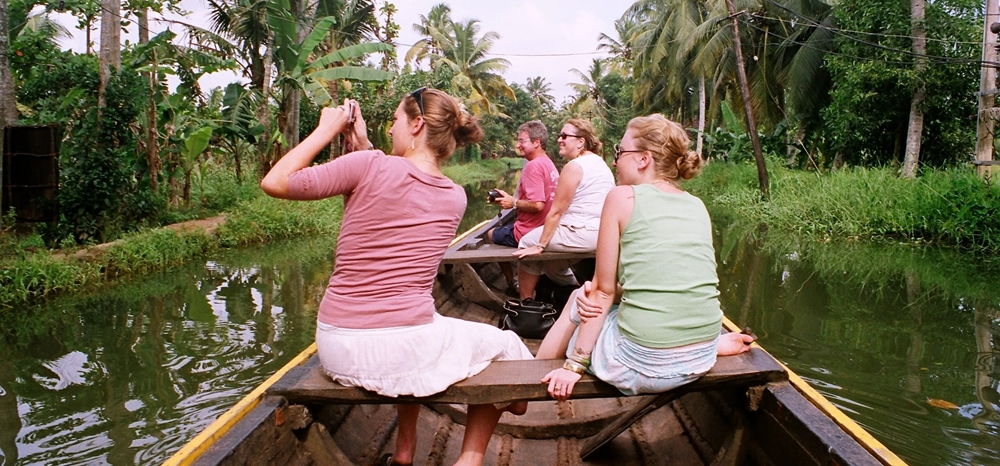 Family enjoying a canoe ride in the Kerala backwaters