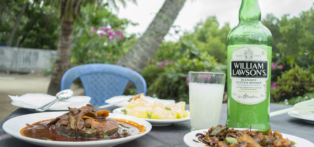 Kerala spicy food with whisky