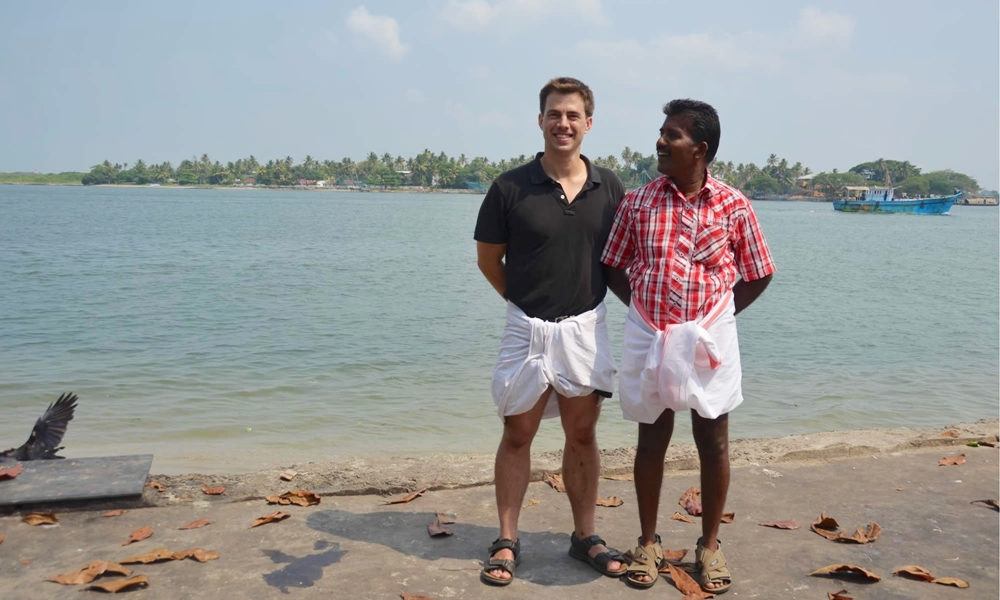 A Malayali with a foreign tourist